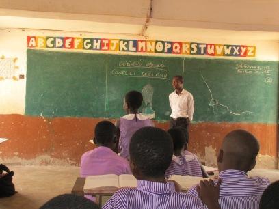 Class 6 teacher Osborn discussing conflict resolution.