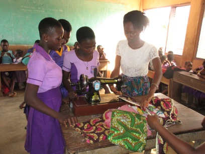 Girls learning Sewing Machine. The make and sell accessories.