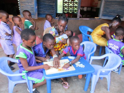 Esther and kids with puzzles!
