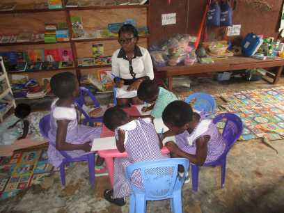 Kate working with children in Resource Room