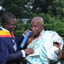 Francis giving honorary doctorate to father
