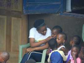 Angie with small ones at recess.